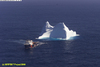 Vessel towing iceberg